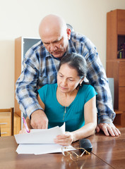 serious mature woman fills documents