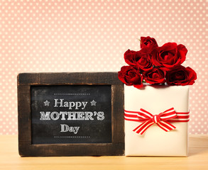 Happy Mothers Day message with roses and present box