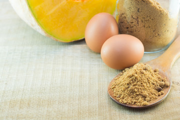 Brown Sugar eggs whit Pumpkinon wooden , Food and health concept