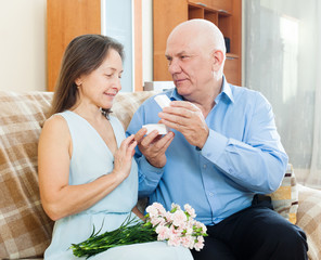 Mature man giving  wife the  jewel box
