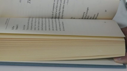 Closeup of flipping the pages of a book