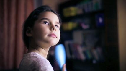 Teen girl child straightens hair combs her  hair brunette