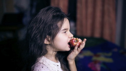 Teen girl child eating  an apple  bites healthy  diet for six