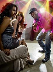 pickup artists harrassing women at a nightclub
