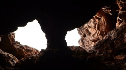 Light Rays Shine inside of Lava Tube Cave