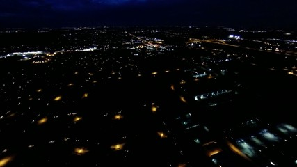Aerial night view of house lights, streets and buildings