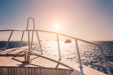 Yacht in the red sea at sunset
