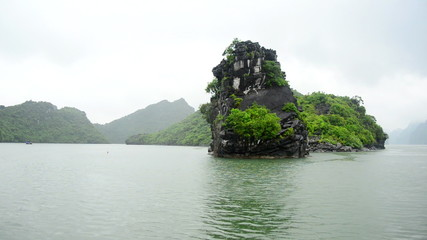Time Lapse of Boats POV on a Rainy Foggy Day in Ha Long Bay Vietnam