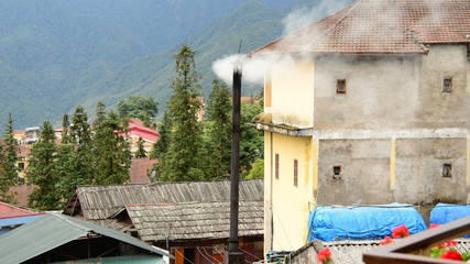 Sapa Vietnam  - Smoke Rises from Vent on a Rooftop