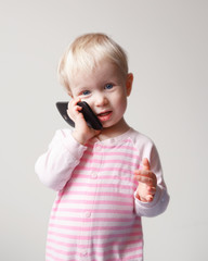 Baby talking over phone