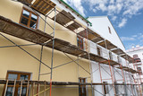 Scaffolding covering a building under restoration - 78877447