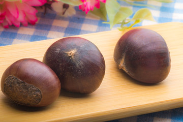 chestnuts on the wooden plate
