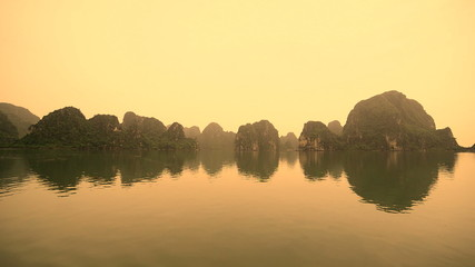 Colorized Time Lapse of Boats POV on a Rainy Foggy Day in Ha Long Bay Vietnam
