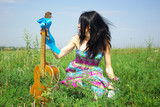 Hippie posing outdoor with guitar. Boho-chic. Boho style. poster