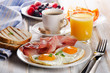 Leinwandbild Motiv Coffee cup, Two  eggs  and bacon for healthy breakfast
