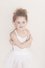 Young ballerina smiling in studio