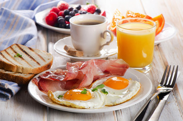 Coffee cup, Two eggs and bacon for healthy breakfast