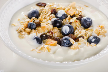 Healthy breakfast - yogurt with blueberries and muesli served in
