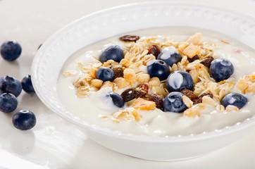 Healthy breakfast - yogurt with fresh blueberries and muesli