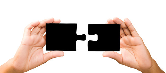 connection concept. hands with pieces of black puzzle.