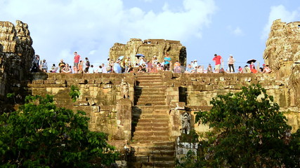 Zoom Out - Time Lapse - Tourists on top of Ancient Temple Waiting for the Sunset - Angkor Wat, Cambodia