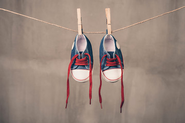 Baby sneakers hanging on the clothesline