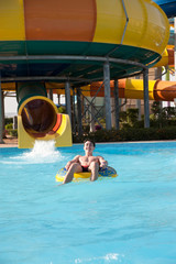 men with rubber rings in the water park
