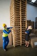 Warehouse worker and his manager looking stack of pallet