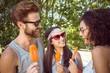 Hipster friends enjoying ice lollies - 78883815