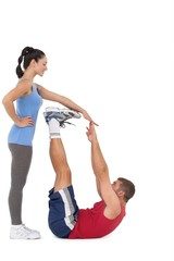 Trainer helping her client stretch legs