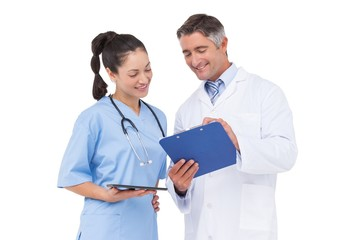 Doctor and nurse looking at clipboard