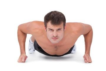 Fit shirtless man doing push ups