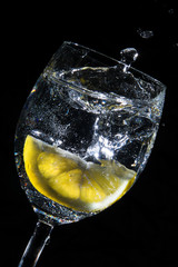 lemon in wather-glas black backgrund