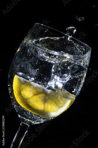 lemon in wather-glas black backgrund - 78885299