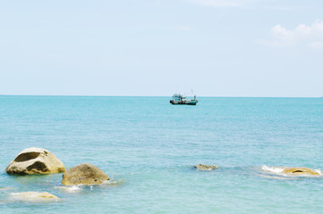 Sea landscape with  ship on horizon. Koh Samui, Thailand.