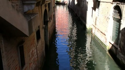 Evening gondola ride along the canals of Venice. Italy