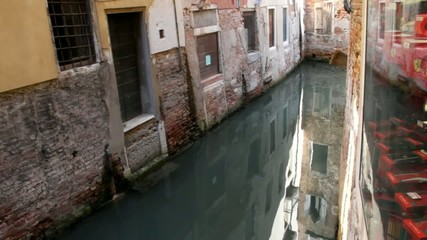 Evening reflection on the water of canal. Venice.