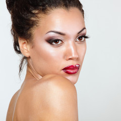 Young mulatto fresh woman with beautiful makeup, isolated