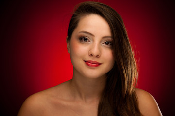 Beauty portrait of a cute caucasian woman over red background