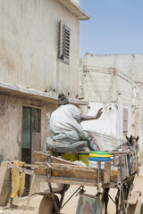 African, driver waving his hand to say hello
