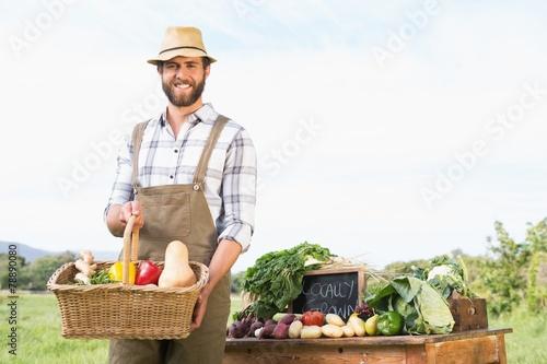 Keuken foto achterwand Boodschappen Farmer holding basket of vegetables at market