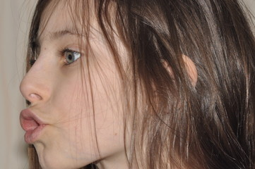 Portrait of a teenager. Brunette with long hair.
