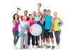 Happy people with exercise equipment - 78890844