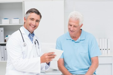 Doctor explaining prescription to senior man