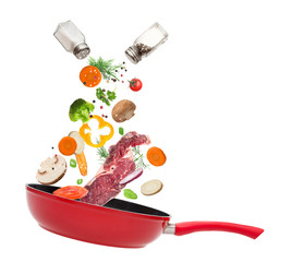 Pan with vegetables in freeze motion