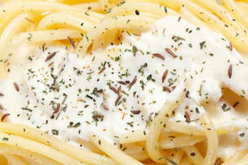 Cooked pasta with cream sauce.
