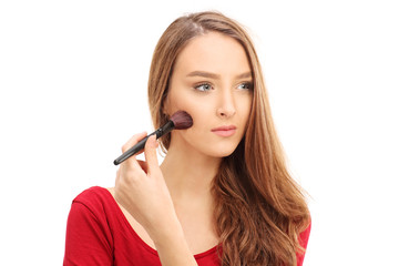 Beautiful woman putting on make-up