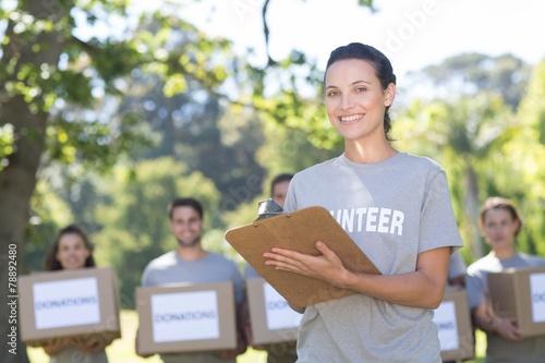 Happy volunteers in the park - 78892480