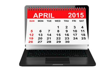 April calendar over laptop screen