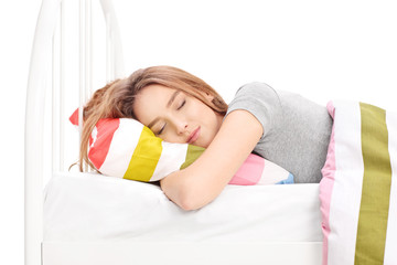 Young woman sleeping in a comfortable bed